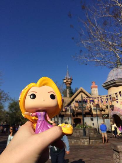 Rapunzel with her village and tower in the distance.